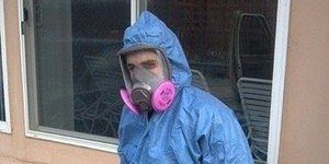 Mold Cleanup Technician In Full Gear