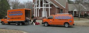 Water Damage and Mold Removal Vehicles At Job Site