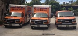 Fleet Of Water Damage and Mold Removal Vehicles
